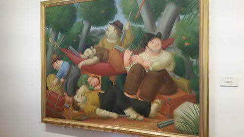 Peinture encadré représentant des hommes se reposant avec des fusils